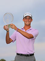 15 OCT 25  Smylie Kaufman holds his trophy on 18 at the conclusion of Sunday's Final Round of The Shriners Hospitals for Children Open at The TPC Summerlin in Las Vegas, Nevada.(photo credit : kenneth e. dennis/kendennisphoto.com)