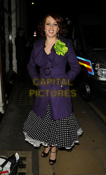 "SARAH CAWOOD.""Confessions Of A Shopaholic"" UK premiere afterparty, Aspreys, Bond St.,, London, England..February 16th, 2009.after party full length purple coat red gloves black peep toe mary janes shoes polka dot white dress skirt green flower corsage Sara hands in pockets .CAP/CAN.©Can Nguyen/Capital Pictures."