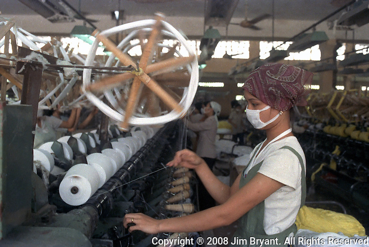 Workers work at textile weaving machines at a towel factory in Hanoi. Jim Bryant Photo.....