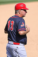Peoria Chiefs manager Joe Kruzel (13) gives signs to a hitter during a game against the Wisconsin Timber Rattlers on April 25th, 2015 at Fox Cities Stadium in Appleton, Wisconsin.  Wisconsin defeated Peoria 2-0.  (Brad Krause/Four Seam Images)