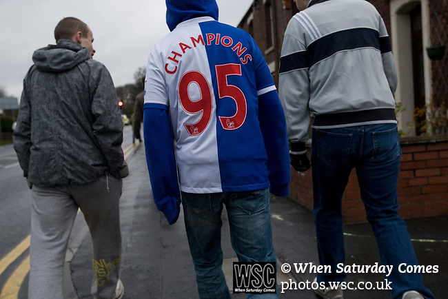 Fans walking away from Ewood Park, home of Blackburn Rovers, after the club played host to Aston Villa in a Barclays Premier League match. Blackburn won the match by two goals to nil watched by a crowd of 21,848. It was Rovers' first match under the ownership of Indian company Venky's.