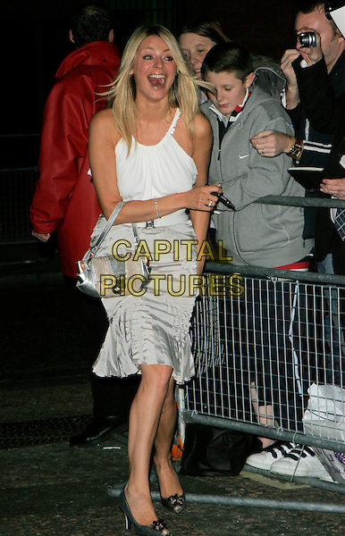 TESS DALY.Leaving The Daily Mirror's Pride Of Britain Awards, London Television Studios, London, UK..November 6th, 2006.Ref: AH.full length Daley grey gray skirt white top mouth open funny.www.capitalpictures.com.sales@capitalpictures.com.©Adam Houghton/Capital Pictures.