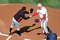 Philadelphia Phillies manager Charlie Manuel greets Ozzie Guillen during their home opener against the Miami Marlins at Citizens Bank Park on April 9, 2012 in Philadelphia, Pennsylvania.  Miami defeated Philadelphia 6-2.  (Mike Janes/Four Seam Images)