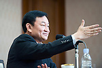 Thaksin Shinawatra, former prime minister of Thailand, takes a question from the floor during a group interview in Tokyo, Japan on 23 Aug. 2011. Photographer: Robert Gilhooly