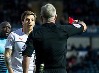 Johnny Mullins of Luton Town receives a red card from Referee Mark Heyward during the Sky Bet League 2 match between Wycombe Wanderers and Luton Town at Adams Park, High Wycombe, England on the 21st January 2017. Photo by Liam McAvoy.