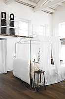 """The bedroom with its light-framed four-poster bed is known by its owners as the """"night zone"""""""