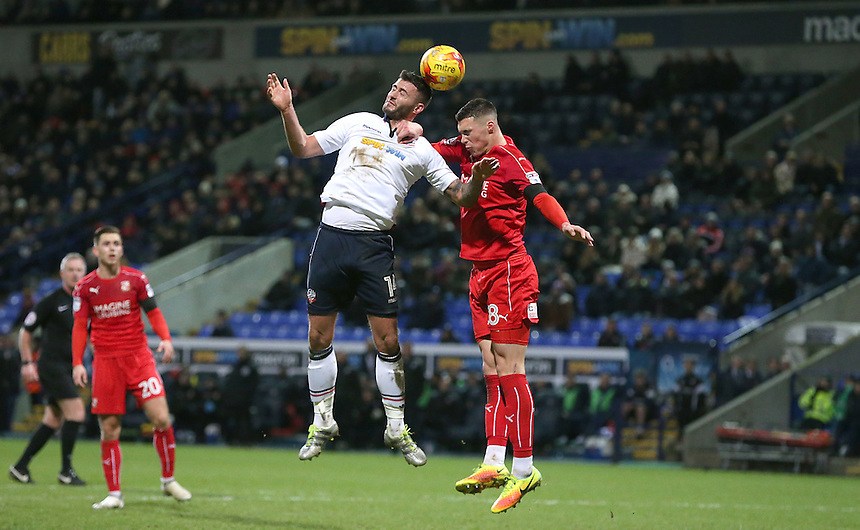 Bolton Wanderers' Gary Madine battles with Swindon Town's Lloyd Jones <br /> <br /> Photographer Stephen White/CameraSport<br /> <br /> The EFL Sky Bet League One - Bolton Wanderers v Swindon Town - Saturday 14th January 2017 - Macron Stadium - Bolton<br /> <br /> World Copyright &copy; 2017 CameraSport. All rights reserved. 43 Linden Ave. Countesthorpe. Leicester. England. LE8 5PG - Tel: +44 (0) 116 277 4147 - admin@camerasport.com - www.camerasport.com