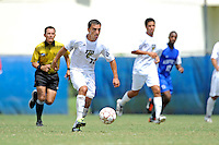 2 October 2011:  FIU midfielder/forward Mario Uribe (17) moves the ball upfield in the second half as the FIU Golden Panthers defeated the University of Kentucky Wildcats, 1-0 in overtime, at University Park Stadium in Miami, Florida.