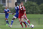 13 January 2015: Daniel Keller (Louisville) (in red) and Dominique Badji (Boston University) (SEN) (behind). The 2015 MLS Player Combine was held on the cricket oval at Central Broward Regional Park in Lauderhill, Florida.