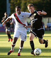 Manchester City defender Dedryck Boyata and Portland Timbers forward George Josten fight for a ball during a match at Merlo Field in Portland Oregon on July 17, 2010.