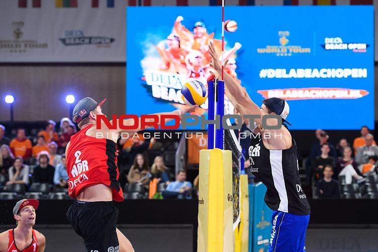 04.01.2019, Den Haag, Sportcampus Zuiderpark<br />Beachvolleyball, FIVB World Tour, 2019 DELA Beach Open<br /><br />Angriff Christian Sorum (#2 NOR) - Block Sven Winter (#2 GER)<br /><br />  Foto &copy; nordphoto / Kurth