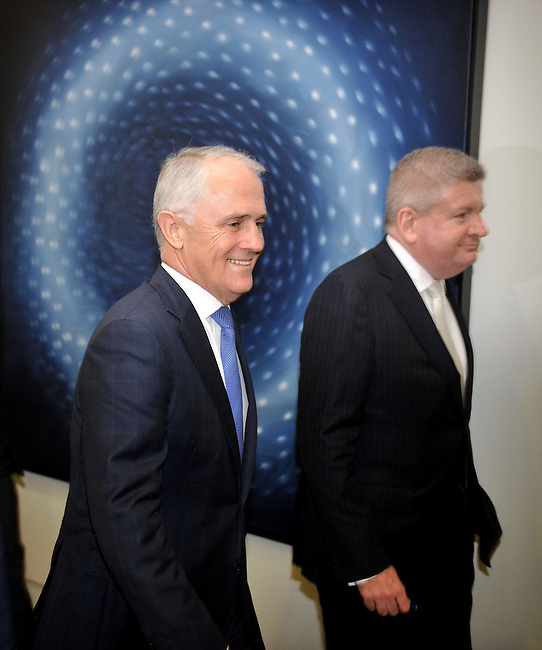 Malcolm Turnbull (L) walks to the Liberal Party room for the ballot for the leadership of the party, Parliament House, Canberra on September 14, 2015. Photographer: Mark Graham/Bloomberg
