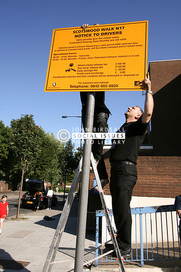 Parking sign being erected in London Borough of Haringey Scotswood Walk housing estate
