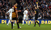 Pictured: (L-R) Ki Sung-Yueng, Angel Rangel, Kevin Friend (referee). Sunday 24 February 2013<br /> Re: Capital One Cup football final, Swansea v Bradford at the Wembley Stadium in London.