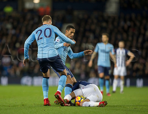 28th November 2017, The Hawthorns, West Bromwich, England; EPL Premier League football, West Bromwich Albion versus Newcastle United; Florian Lejeune and Isaac Hayden of Newcastle United trying lift the ball from Hal Robson Kanu of West Bromwich Albion on the floor