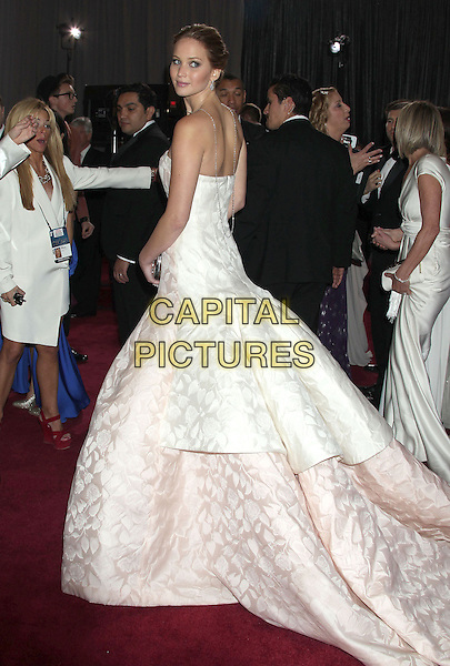 Jennifer Lawrence (wearing Dior Haute Couture).85th Annual Academy Awards held at the Dolby Theatre at Hollywood & Highland Center, Hollywood, California, USA..February 24th, 2013.oscars full length white pale pink strapless dress gown voluminous clutch bag full-tiered skirt looking over shoulder .CAP/ADM/RE.©Russ Elliot/AdMedia/Capital Pictures.