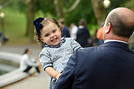 Young girl on dad's shoulder in Central Park.