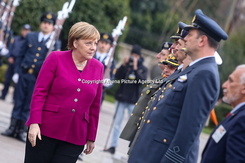 Pictured: German Chancellor Angela Merkel speaks to members of the Armed Forces after she layed a wreath at the Monument to the Unknown Soldier outside the Greek Parliament in Syntagma Square, Athens, Greece.<br /> Re: Official visit of German Chancellor Angela Merkel  to Athens, Greece.