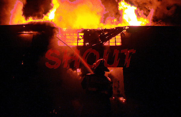 Firefighters attend a large factory fire the fire has already got a hold and can be seen blazing through the roof UK. This image may only be used to portray the subject in a positive manner..©shoutpictures.com..john@shoutpictures.com