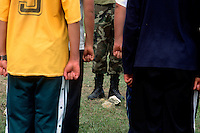 "Bolivian students form up during premilitary training to prepare them for compulsory military service in Vallegrande, Bolivia Saturday, Nov. 13, 2004. The young potential soldiers paraded only two hundred yards from where the body of the executed Ernesto ""Che"" Guevara lay burried with six fellow guerillas for 30 years. A mausoleum now stands over the open mass grave. Just as nearby, the bodies of twleve more guerillas in Guevara's band were burried on the grounds of a local Rotary Club. The remains were repatriated to Cuba after their discovery in 1997. Guevara was captured by the Bolivian army in 1967 in a nearby valley and executed in La Higuera days later. Guevara and fellow communist guerillas were attempting to launch a continent-wide revolution modeled on Guevara's success in Cuba in the late 1950s. The Bolivian government recently began promoting the area where he fought, was captured, killed and burried for 30 years as the ""Ruta del Che,"" or Che's Route. (Kevin Moloney for the New York Times)"