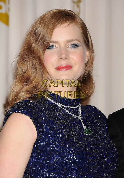 AMY ADAMS.Press room at the 83rd Annual Academy Awards at the Kodak Theatre, Hollywood, California, USA. .February 27th, 2011.pressroom oscars portrait headshot make-up beauty blue navy sequined sequins emerald diamond necklace wavy hair .CAP/ROT/TM.© Tony Michaels/Roth Stock/ Capital Pictures
