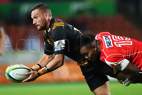 April 29th 2017, FMG Stadium Waikato, Hamilton, New Zealand; Super Rugby; Chiefs versus Sunwolves;  Chiefs first five Aaron Cruden gets a pass away while getting tackled by Sunwolves fullback Kotaro Matsushima during the Super Rugby rugby match