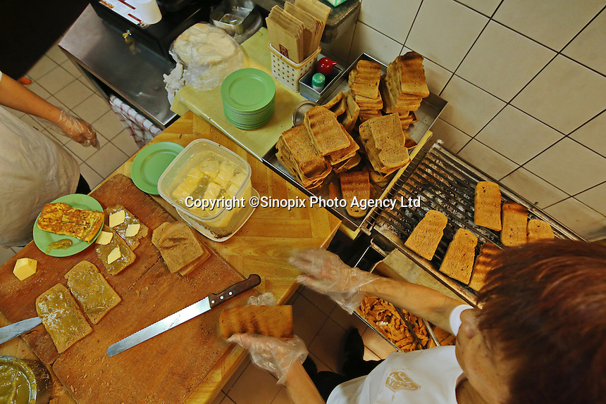 Making the popular breakfast set at the popular breakfast cafe chain Yakun Kaya Toast in Singapore.