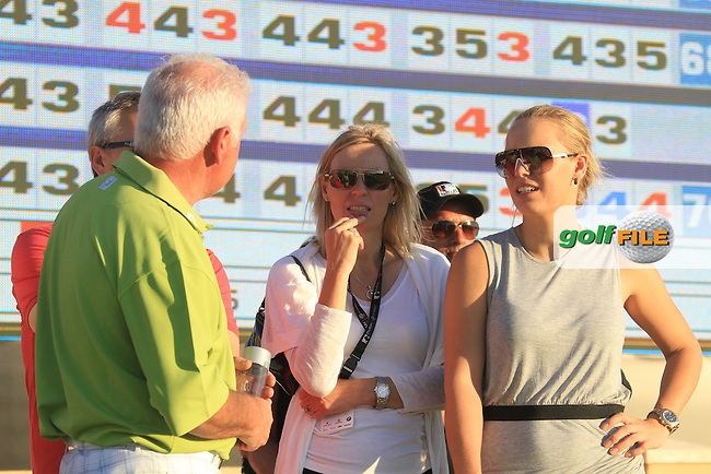 Rory McIlroy (NIR)  father Gerry McIlroy and Girlfriend Caroline Wozniacki on the side of the 18th green on the third day of the DUBAI WORLD CHAMPIONSHIP presented by DP World, Jumeirah Golf Estates, Dubai, United Arab Emirates.Picture Fran Caffrey www.golffile.ie