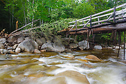 Side view of the Thoreau Falls Trail bridge days after Tropical Storm Irene in 2011. This bridge crosses the East Branch of the Pemigewasset River at North Fork Junction in the Pemigewasset Wilderness of New Hampshire. Tropical Storm Irene caused destruction along the East coast of the United States, and the White Mountain National Forest was officially closed during the storm.