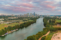 From high above Lady Bird Lake, the Austin skyline rises into the evening clouds on a nice October evening.