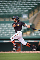 GCL Orioles shortstop Andrew Fregia (19) follows through on a swing during the first game of a doubleheader against the GCL Twins on August 1, 2018 at CenturyLink Sports Complex Fields in Fort Myers, Florida.  GCL Twins defeated GCL Orioles 7-6 in the completion of a suspended game originally started on July 31st, 2018.  (Mike Janes/Four Seam Images)