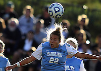 SAN DIEGO, CA - DECEMBER 02, 2012:  Amber Brooks (22) of the University of North Carolina heads against Penn State University during the NCAA 2012 women's college championship match, at Torero Stadium, in San Diego, CA, on Sunday, December 02 2012. Carolina won 4-1.