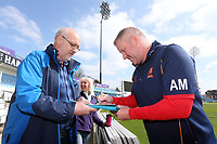 Essex head coach Anthony McGrath signs an autograph for a fan after play is abandoned for the day during Yorkshire CCC vs Essex CCC, Specsavers County Championship Division 1 Cricket at Emerald Headingley Cricket Ground on 14th April 2018