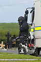 Army Bomb Disposal team are seen in the grounds of St. Coleman's Cemetery, Lurgan, Monday, June 17th, 2019. (Photo by Paul McErlane for the Belfast Telegraph) Army Bomb Disposal team are seen inthe grounds of St. Coleman's Cemetery, Lurgan, Monday, June 17th, 2019. (Photo by Paul McErlane)