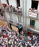 Participants wait the beginning of the sixth San Fermin Festival´s running of the bulls, on July 12, 2013, in Pamplona, Basque Country. On each day of the eight San Fermin festival days six bulls are released at 8:00 a.m. (0600 GMT) to run from their corral through the narrow, cobbled streets of the old navarre town over an 850-meter (yard) course. Ahead of them are the runners, who try to stay close to the bulls without falling over or being gored. (Ander Gillenea / Bostok Photo)