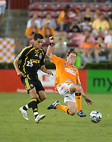 Houston Dynamo midfielder Richard Mulrooney (30) strips the ball from Columbus Crew forward Ricardo Virtuoso (25). The Houston Dynamo tied the Columbus Crew 1-1 in a regular season MLS match at Robertson Stadium in Houston, TX on August 25, 2007.