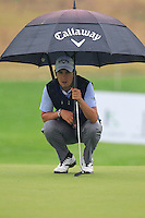 Matteo Manassero (ITA) on the 1st green during Thursday's Round 1 of the 2014 BMW Masters held at Lake Malaren, Shanghai, China 30th October 2014.<br /> Picture: Eoin Clarke www.golffile.ie