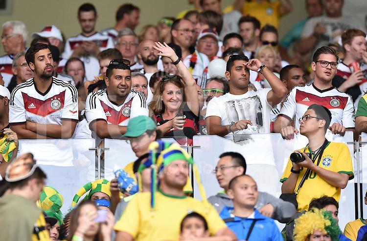 FUSSBALL WM 2014                HALBFINALE Brasilien - Deutschland          08.07.2014 Rahni Khedira (li) schaut von der Tribuene aus das Spiel