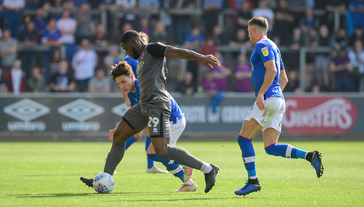 Lincoln City's John Akinde vies for possession with Carlisle United's Callum O'Hare<br /> <br /> Photographer Chris Vaughan/CameraSport<br /> <br /> The EFL Sky Bet League Two - Carlisle United v Lincoln City - Friday 19th April 2019 - Brunton Park - Carlisle<br /> <br /> World Copyright © 2019 CameraSport. All rights reserved. 43 Linden Ave. Countesthorpe. Leicester. England. LE8 5PG - Tel: +44 (0) 116 277 4147 - admin@camerasport.com - www.camerasport.com