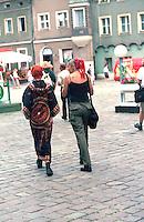 Friends age 18 walking down sidewalk.  Poznan Poland