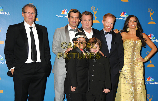 'MODERN FAMILY'.cast and crew.62nd Annual Primetime Emmy Awards held at NOKIA Theatre Los Angeles, California, USA. .29th August 2010.half length black suit grey gray yellow gold dress.CAP/ADM/BP.©Byron Purvis/AdMedia/Capital Pictures.
