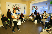 (171126RREI2182) Many Languages One Voice,  MLOV,  Holiday Celebration and Immigrant Legal Rights Workshop in La Casa, Mt. Pleasant. MLOV is on the same block as La Esquina where Latinos have gathered for decades at the corner of Mt. Pleasant St. and Kenyon St. NW. to play chekers (damas). MLOV Exec. Dir. Sapna Pandya, (beating drum in black), Anna (with drum in white).  Washington DC.  Nov. 26 ,2017 . ©  Rick Reinhard  2017     email   rick@rickreinhard.com