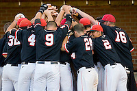 The St. John's Red Storm huddle up before taking on the Virginia Cavaliers in the championship game of the Charlottesville Regional at Davenport Field on June 5, 2010, in Charlottesville, Virginia.  The Cavaliers defeated the Red Storm 5-3.  Photo by Brian Westerholt / Four Seam Images