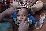 MATHAHALIBAH, KENYA - JULY 4: An unidentified child gets treatment while visiting a Save the Children outreach site in the location on July 4, 2011 in Mathahalibah, Kenya. The team examined about thirty children, among them several severely malnourished. Women come with their children once a week to the outreach site to receive food and medicine. Two successive poor rains, entrenched poverty and lack of investment in affected areas have pushed millions of people into a fight for survival in the Horn of Africa. This is the driest this area have been since sixty years. (Photo by Per-Anders Pettersson)