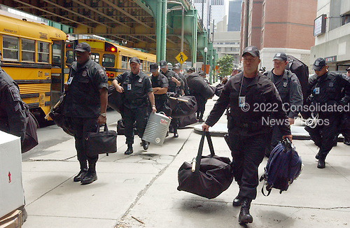 Boston, MA - July  25, 2004 -- Boston City Police Officers prepare to deploy around the FleetCenter in Boston, Massachusetts on July 25, 2004..Credit: Ron Sachs / CNP