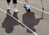 BENSALEM, PA - JUNE 21:  Bunny Moyer (L) of Colorado and Bob Heffernan of Bensalem, Pennsylvania and their shadows walk during the 15th annual Relay for Life to benefit the American Cancer Society June 21, 2014 at Bensalem Memorial Stadium in Bensalem, Pennsylvania.   Teams of cancer survivors and other participants walked around the school's track to raise money for cancer research. (Photo by William Thomas Cain/Cain Images)