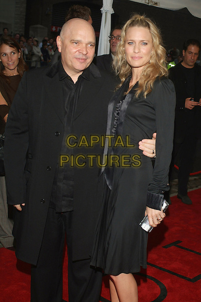 "ANTHONY MINGHELLA & ROBIN WRIGHT PENN.""Breaking and Entering"" Premiere during the 2006 Toronto International Film Festival held at Roy Thomson Hall, Toronto, Ontario, Canada..September 13th, 2006.Ref: ADM/BPC.half length black suit jacket coat dress silver clutch purse  www.capitalpictures.com.sales@capitalpictures.com.©Brent Perniac/AdMedia/Capital Pictures"