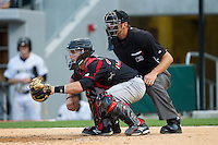 Rochester Red Wings catcher Eric Fryer (25) sets a target as home plate umpire Travis Carlson looks on during the game against the Charlotte Knights at BB&T Ballpark on June 5, 2014 in Charlotte, North Carolina.  The Knights defeated the Red Wings 7-6.  (Brian Westerholt/Four Seam Images)