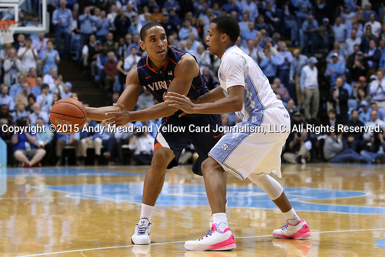 02 February 2015: Virginia's Malcolm Brogdon (left) and North Carolina's Nate Britt (right). The University of North Carolina Tar Heels played the University of Virginia Cavaliers in an NCAA Division I Men's basketball game at the Dean E. Smith Center in Chapel Hill, North Carolina. Virginia won the game 75-64.