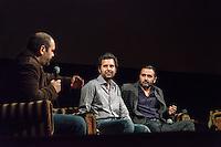 Amsterdam, 26-11-2013, International Documentary Film Festival 2013. Vrij Nederland-redacteur Harm Ede Botje spreekt met de filmmakers van Return to Homs, over de strijd van de jonge revolutionairen die zij portretteren in deze zeldzaam intieme film over een groep vrienden in Homs, Syri&euml;.  Orwa Nyrabia (l), en Talal Derki. Photo: Nichon Glerum IDFA 2013: Q and A session after screening of Return to Homs:<br /> From left:  Orwa Nyrabia, unnamed interpreter, Talal Derki. Photo: Nichon Glerum